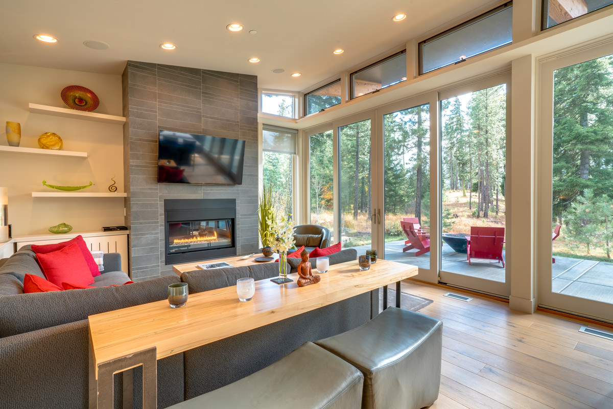 Open Living room with windows and modern fireplace