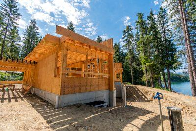 Merle Inc. framing house near a mountain lake